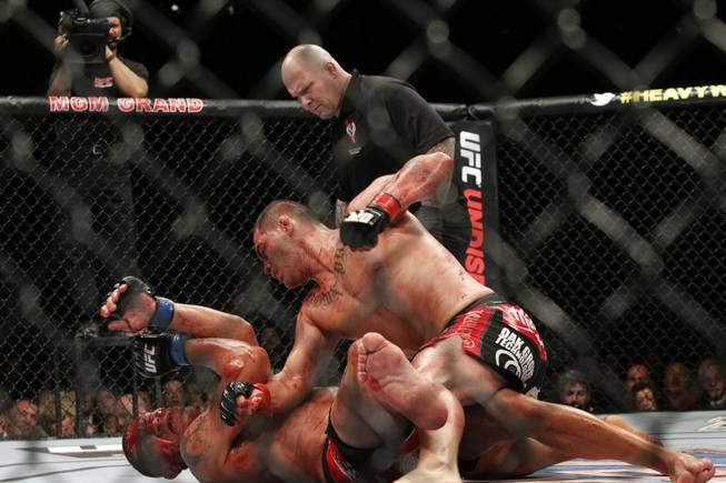 Cain Velasquez, right, of San Jose, Calif. pounds a bloodied Antonio Silva of Brazil during UFC 146 at the MGM Grand Garden Arena Saturday, May 26, 2012.