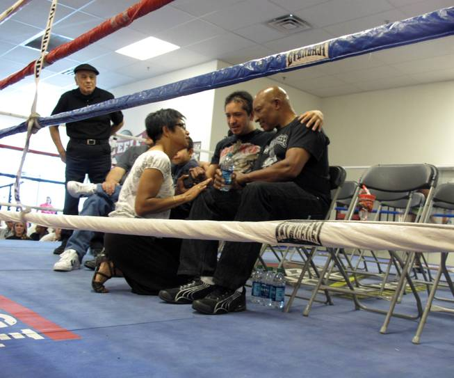 Arturo Martinez-Sanchez, center, sits next to Richard Steele, right, and talks to a fundraiser attendee. Steele organized a fundraiser Saturday afternoon during a boxing event at the Richard Steele Gym and Boxing Club, 2475 W. Cheyenne Ave. in North Las Vegas.