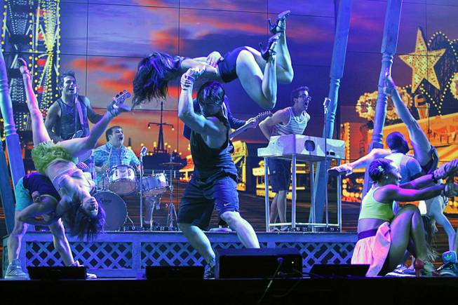 "Cast members, including Nikki Tuazon (center, top) and Colt Prattes (center, bottom), perform in the ""Dance, Dance, Dance"" scene during a media preview of ""Surf the Musical"" at Planet Hollywood on Tuesday, May 29, 2012. The new production show, featuring the songs of The Beach Boys, is expected to open at the resort in mid-June."