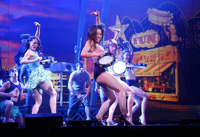 "Cast members, including Nikki Tuazon, center, perform in the ""Dance, Dance, Dance"" scene during a media preview of ""Surf the Musical"" at Planet Hollywood on Tuesday, May 29, 2012."