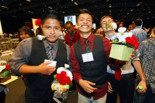 Del Sol High School students, including Andy Escamillo, left, and Julio Veano, center, celebrate during an event, sponsored by MGM Resorts International, recognizing the achievements of about 500 high school students at MGM Grand Thursday, May 31, 2012. The event highlighted the impact of the Reclaim Your Future initiatives implemented by CCSD through the support of community partners, volunteers and staff. The initiatives assist students whose attendance, credits or proficiency exam results put them at risk not to graduate.