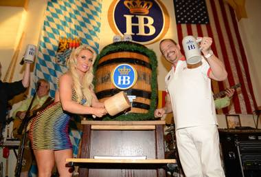 Coco Austin taps the keg at Hofbrauhaus on Friday, May 31, 2013. Husband Ice-T joined her.