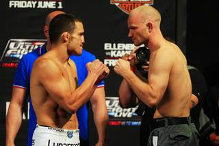 Jake Ellenberger, left, and Martin Kampmann face off during the weigh in for The Ultimate Fighter 15 Thursday, May 31, 2012.