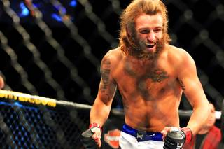 Mike Chiesa celebrates his submission victory over Al Iaquinta in their lightweight bout at The Ultimate Fighter 15 Friday, June 1 2012.