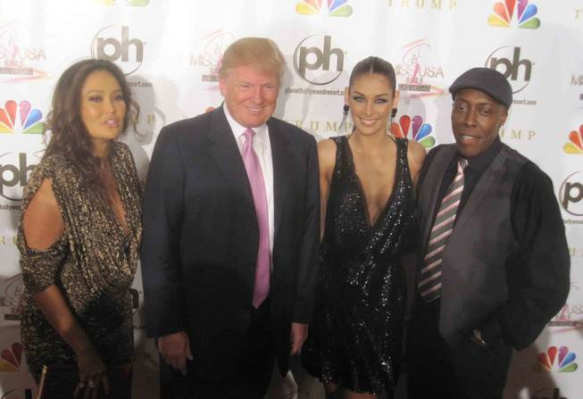 Tia Carerre, Donald Trump, Dayana Mendoza and Arsenio Hall on the 2012 Miss USA Pageant red carpet at Planet Hollywood on Sunday, June 3, 2012.