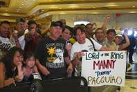 Fans wait for boxer and Filipino congressman Manny Pacquiao at the MGM Grand Tuesday, June 5, 2012. Pacquiao will defend his WBO welterweight title against undefeated boxer Timothy Bradley Jr. at the MGM Grand Garden Arena Saturday.