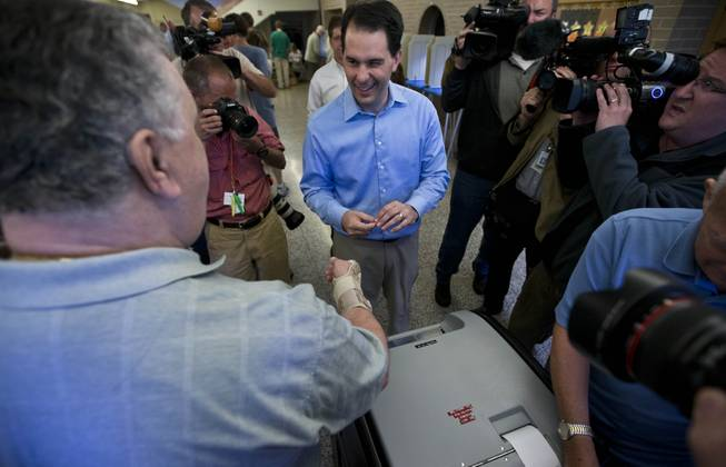 Wisconsin Republican Gov. Scott Walker casts his ballot Tuesday, June 5, 2012, in Wauwatosa, Wis. Walker faces Democratic challenger Tom Barrett in a special recall election.