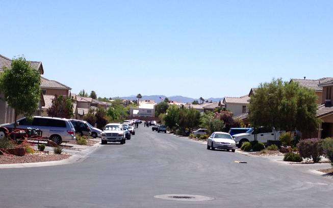 A view into the neighborhood where Metro Police located a suspect accused of fatally shooting a man Wednesday morning near Windmill Parkway and La Serna Street.