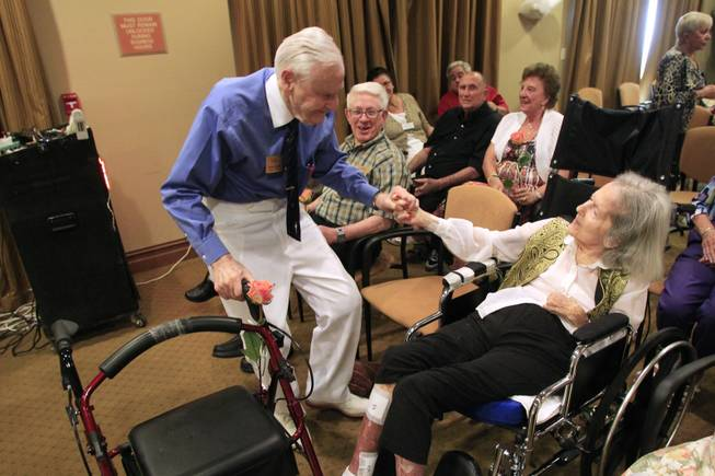 "While Glenn Miller's ""Chattanooga Choo Choo"" plays, Herb Lowe holds his wife Bonnie's hand while he dances during a wedding vow renewal ceremony at Las Ventanas Wednesday, June 6, 2012. The Lowes have been married for 72 years."