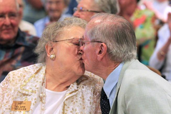 Elaine and Ron Stoller, married for 63 years, smooch at the conclusion of a wedding vow renewal ceremony at Las Ventanas Wednesday, June 6, 2012.