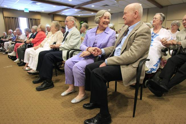 Marilyn and Herb Steege hold hands during a wedding vow renewal ceremony at Las Ventanas Wednesday, June 6, 2012.