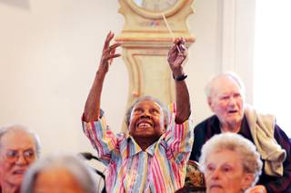 Resident Elnora Holland gets excited during a Conductorcise session with Maestro David Dworkin at the Cottages of Green Valley in Henderson on Friday, June 8, 2012.