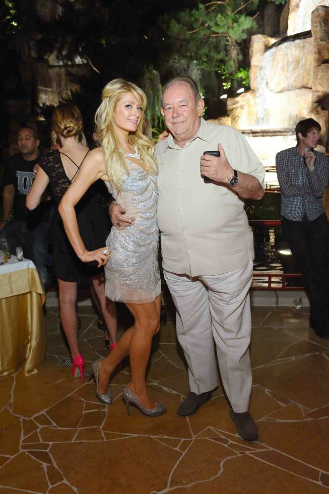 Paris Hilton and Robin Leach at the grand-opening party for Mizumi at the Wynn on Thursday, June 7, 2012.