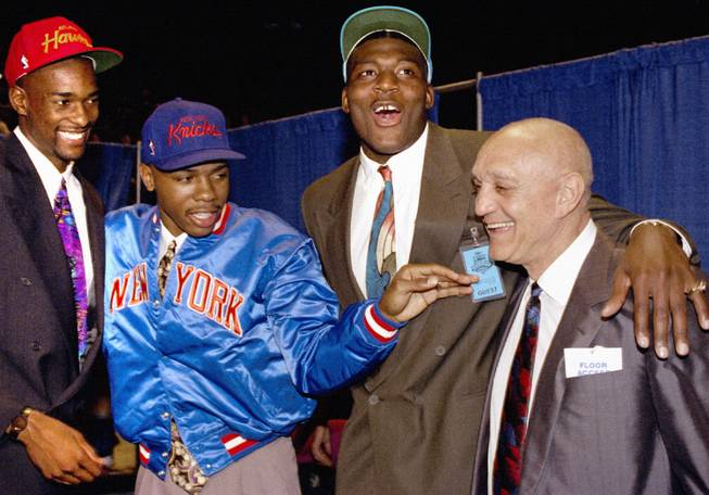 From left, former Rebels Stacey Augmon, Greg Anthony and Larry Johnson celebrate with coach Jerry Tarkanian in New York City at the 1991 NBA Draft, when all three were selected in the first round. Augmon will be inducted into the Southern Nevada Sports Hall of Fame on Friday, an honor previously bestowed upon both of his teammates and his coach.