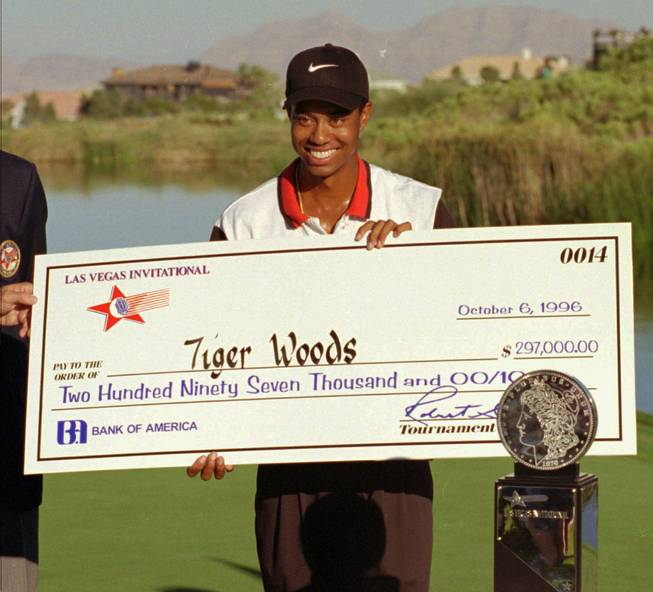 Tiger Woods smiles after winning the 1996 Las Vegas Invitational, which was his first victory on the PGA Tour.