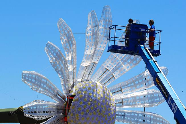 Workers put the finishing touches on a giant daisy for the Electric Daisy Carnival Thursday, June 7, 2012 at the Las Vegas Motor Speedway.
