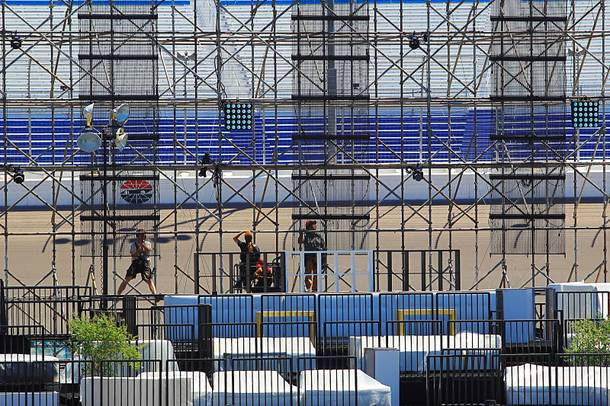 Workers put together the final touches for the Electric Daisy Carnival Thursday, June 7, 2012 at the Las Vegas Motor Speedway.
