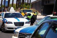 Taxicab Authority Police stop taxis at a long haul checkpoint near the entrance to the airport tunnel exiting McCarran International Airport in Las Vegas on Friday, June 8, 2012.
