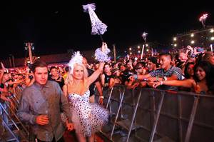 "Electric Daisy Carnival founder Pasquale Rotella and reality TV and ""Peepshow"" star Holly Madison make their way through the crowd during the first night of the Electric Daisy Carnival early Saturday, June 9, 2012, at Las Vegas Motor Speedway."