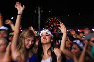 Concertgoers dance during the first night of the Electric Daisy Carnival early Saturday, June 9, 2012, at Las Vegas Motor Speedway.