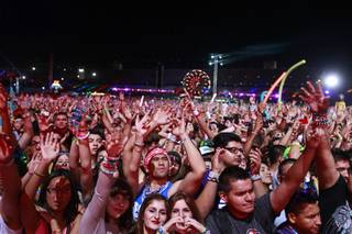 Festival-goers listen to electronic dance music at the kinetic FIELD during the final night of the Electric Daisy Carnival at the Las Vegas Motor Speedway Sunday night/Monday morning June 11, 2012.