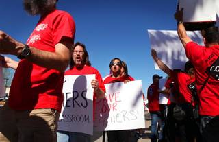 Teachers rally during a protest organized by the Clark County Education Association on Monday, June 11, 2012, outside the Clark County School District Administration building on West Sahara Avenue in Las Vegas.