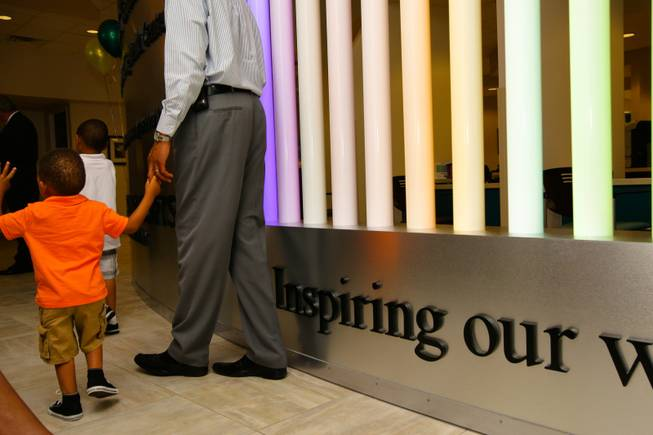 Two-year-old Miles Russell II takes a tour of the Martin Luther King Health Center with his dad, Miles Russell, during its opening Monday, June 11, 2012, in Las Vegas. The Affordable Care Act included $728 million in grants for community health centers like the Martin Luther King Health Center, which expects to treat 11,000 patients annually.