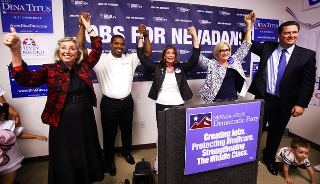 Candidates Dina Titus, from left, Steven Horsford, Rep. Shelley Berkley D-Nev., Nevada State Democratic Party chair Roberta Lange, and John Oceguera pose for a photo during a primary election night party at the new Nevada Democratic Party Field Office in Henderson on Tuesday, June 12, 2012.