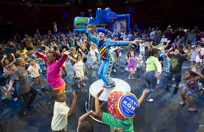 Clown Billy Murray leads children in a dance during Ringling Bros. and Barnum & Bailey pre-show at the Thomas & Mack Center Thursday, June 14, 2012. The circus will perform through Sunday.