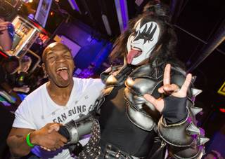 Mike Tyson, Gene Simmons and Shannon Tweed at KISS by Monster Mini Golf on Wednesday, June 13, 2012.