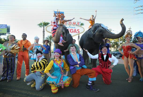 Ringling Bros. and Barnum and Baily circus members at the Welcome to Fabulous Las Vegas sign on Wednesday, June 13, 2012.