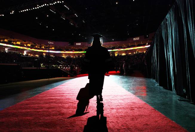 A student walks out into the arena during the Chaparral High School commencement ceremony at the Orleans Arena on Friday, June 15, 2012.