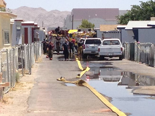 Emergency vehicles, firefighters and police remain on the scene of a fire this morning on Las Vegas Boulevard North that claimed the lives of three children under the age of 3.