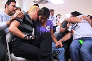 Raphael Lopez gets a hug from Barbara Silva as they listen to President Obama's announcement of new immigration reforms Friday, June 15, 2012 at the offices of the Progressive Leadership Alliance of Nevada. Lopez, a student at UNLV, was brought into the United States when he was one-year-old.
