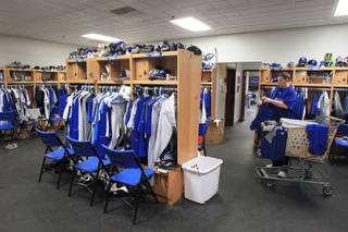 Las Vegas 51s clubhouse manager Steve Dwyer begins the process of sorting, folding and putting away laundry Friday, June 15, 2012.