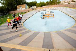 Working on balance and maneuverability, students play Lali-ball during practice Saturday, June 16, 2012, at Lali O's Roller Derby School. The 98 x 60 regulation banked track is located in Lali O's backyard.