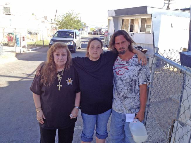 From left, residents Helen Miller, Sheilla Robbins and Robert Hicks are shown at the Van's Trailer Oasis mobile home park on Las Vegas Boulevard North near Lamb Boulevard.