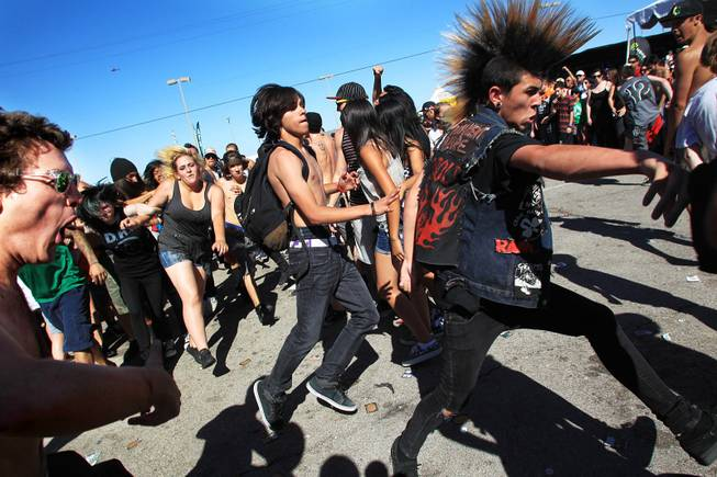 Fans form a mosh pit during the Las Vegas stop of the Vans Warped Tour Wednesday, June 20, 2012.
