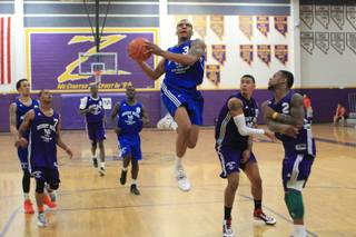 Anthony Marshall drives to the basket during the Desert Reign league game Wednesday, June 20, 2012.