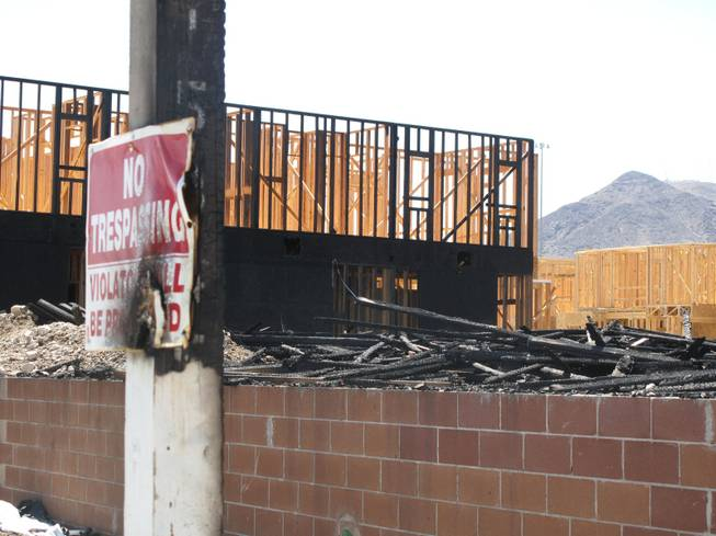 Signs and poles near Wigwam Street were scorched by an early morning fire at an apartment construction site. Fire crews responded to an early morning fire at 1131 Wigwam St., the future site of Theory Apartments on Wednesday , June 20, 2012.