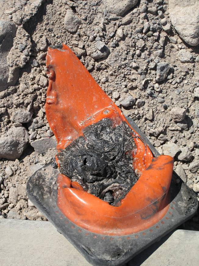 A melted cones near Wigwam Street is seen at the site of an early morning fire at an apartment construction site. Fire crews responded to an early morning fire at 1131 Wigwam, the future site of Theory Apartments on Wednesday , June 20, 2012.