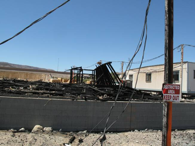 Signs and poles near Wigwam Street were scorched by an early morning fire at an apartment construction site. Fire crews responded to an early morning fire at 1131 Wigwam St., the future site of Theory Apartments on Wednesday , June 20, 2012.Yasmina Chavez