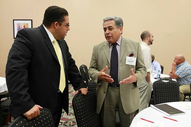 Stavan Corbett, left, president of the State Board of Education, speaks with Fernando Romero, regional field coordinator for the National Council of La Raza,during the English Mastery for Nevada's Prosperity education forum at the Stan Fulton Building on UNLV campus Thursday, June 21, 2012.