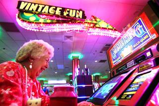 Eileen Brown of Henderson plays the machines while waiting for bingo to start at the Eldorado Casino in downtown Henderson on Friday, June 22, 2012.