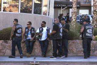 Members of the Mongols Motorcycle Club stand guard outside the Boulder City Inn and Suites as they hold their annual convention in Boulder City Saturday, June 23, 2012.