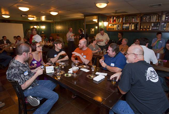 Patrons chat during a monthly cask beer event at the Freakin' Frog Cafe & Beer Bar, 4700 S. Maryland Parkway, Monday, June 25, 2012.