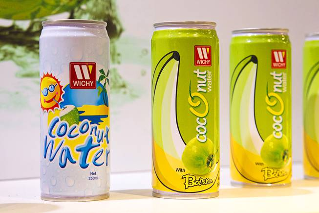 Coconut water and coconut water with banana extract from Sri Lanka are displayed at the Wichy booth during the IFT Food Expo at the Las Vegas Convention Center, June 25, 2012. The coconut water with banana extract will be on the market soon, said Kushan Perera.