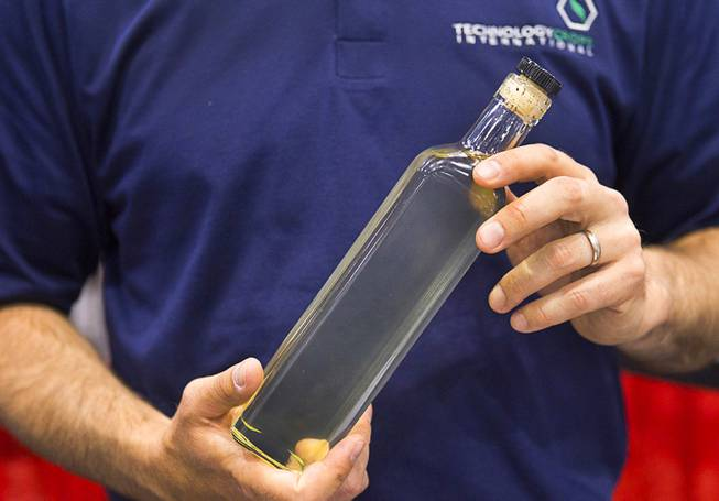 Steve Howatt of Technology Crops holds a bottle of oil during the IFT Food Expo at the Las Vegas Convention Center, June 25, 2012. A new oil from the Ahi flower (also called a Field Gromwell, Buglossoides Arvensis) will provide a plant-derived, natural source of Omega-3 and Omega-6 fatty acids, he said.