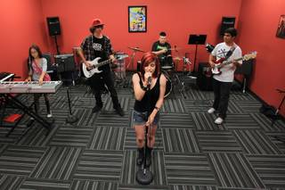 Vocalist Austi Martines and, from left, Kaelin Wilson, Ian Rollwitz, Sean Hall Jaramillo and Ethan Ritchie rehearse at the Las Vegas School of Rock location Tuesday, June 26, 2012.