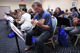 Forrest Jones plays a vihuela during a mariachi workshop for music teachers from around the country Wednesday, June 27, 2012.